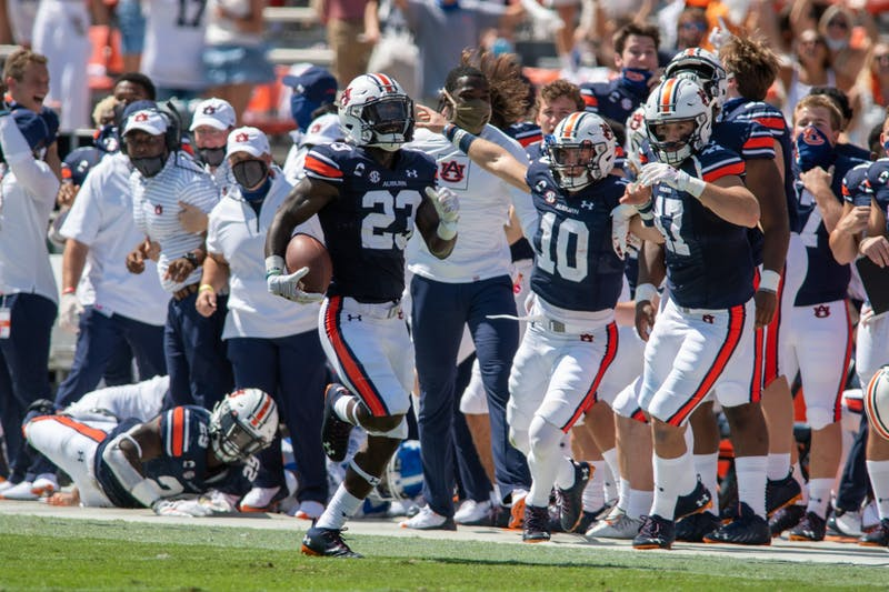 Roger McCreary (23) sprints down the field as Bo Nix (10) cheers on the sideline during Auburn Football vs. Kentucky on Saturday, Sept. 26, 2020, in Auburn, Ala.