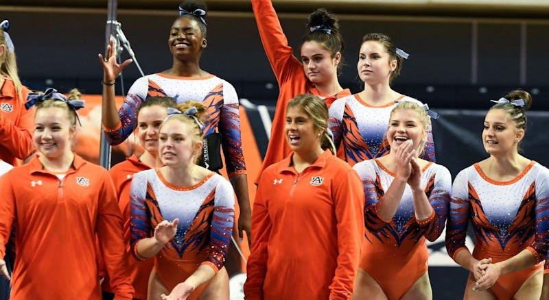 Auburn gymnasts cheer during Auburn gymnastics vs. Alabama on Jan. 10, 2020, in Auburn, Ala.