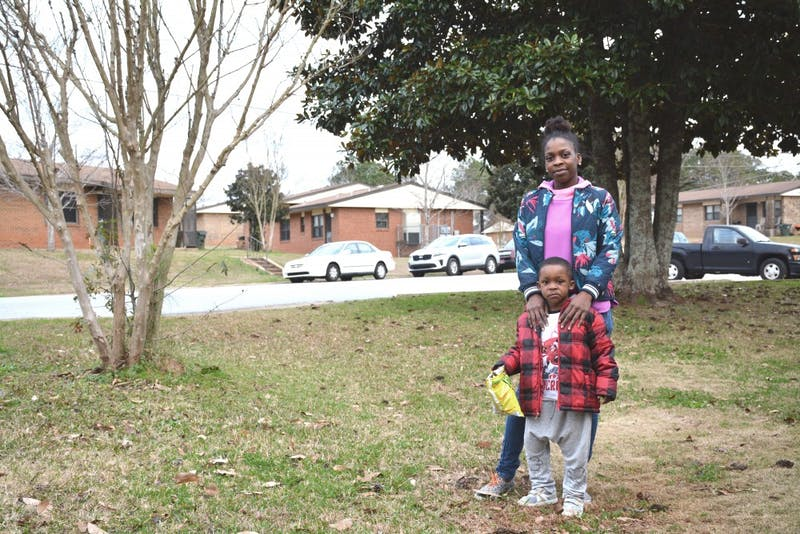 Gabrielle Johnson and her son, Bryson-Elijah, stand outside their home in Auburn, Alabama, on Jan. 22, 2019.