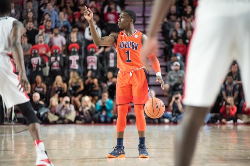 Jared Harper (1) directs the Auburn offense during Auburn Basketball vs. Georgia on Saturday, Feb. 10, 2018, at Stegeman Coliseum in Athens, Ga.