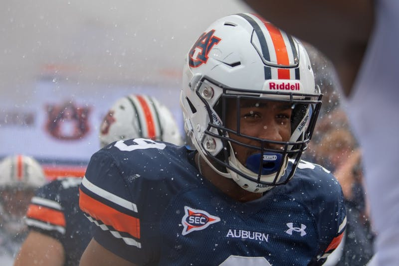 Kam Martin (9) runs out of the tunnel during A-Day 2019, on Saturday, April 13, 2019, in Auburn, Ala.