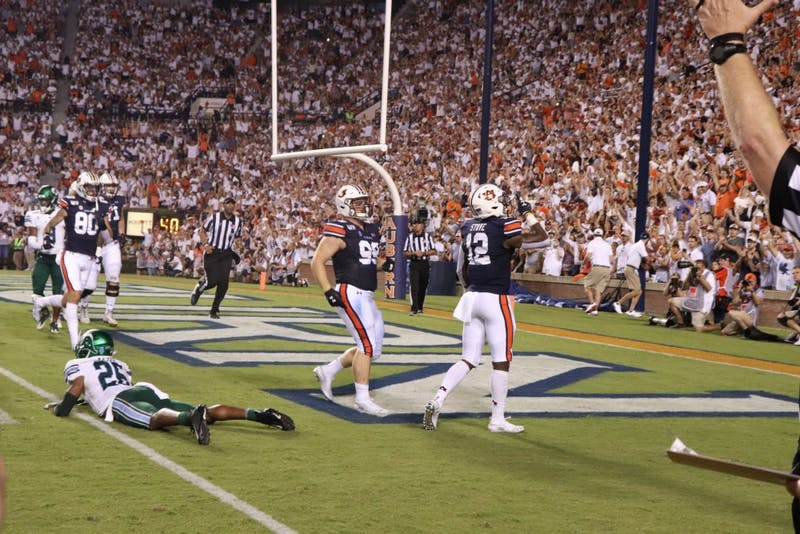 Eli Stove (12) celebrating after making a touchdown during Auburn Football vs. Tulane on Sep. 7, 2019, in Auburn, Ala.