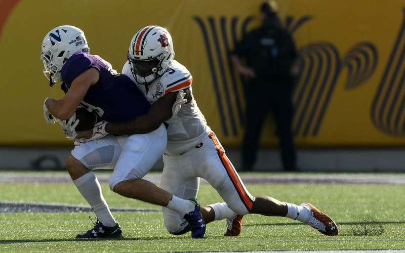 Zakoby McClain (9) makes the open field tackle during the game between Auburn vs Northwestern at Orlando on Jan 1, 2021; Orlando FL, USA. Photo via: Todd Van Emst/AU Athletics