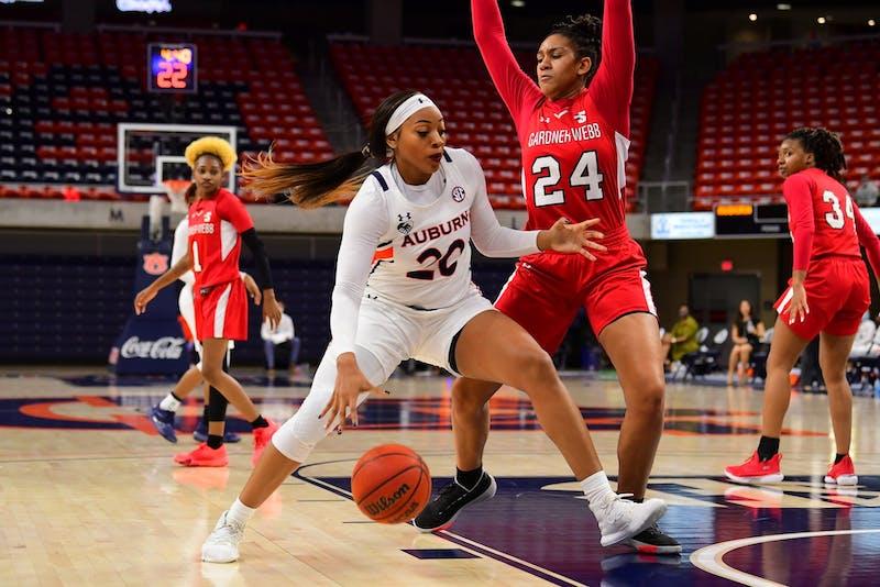 Dec 1, 2020; Auburn, AL, USA; Unique Thompson (20) drives to the basket during the game between Auburn and Gardner-Webb at Auburn Arena. Mandatory Credit: Shanna Lockwood/AU Athletics