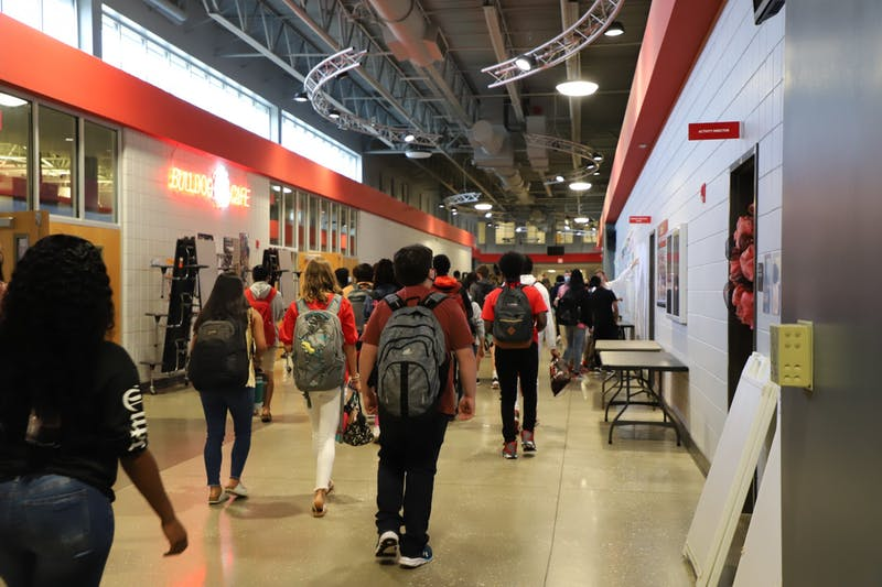 Students walk the halls of Opelika High School on the first day of classes on Aug. 9, 2021, in Opelika, Ala.