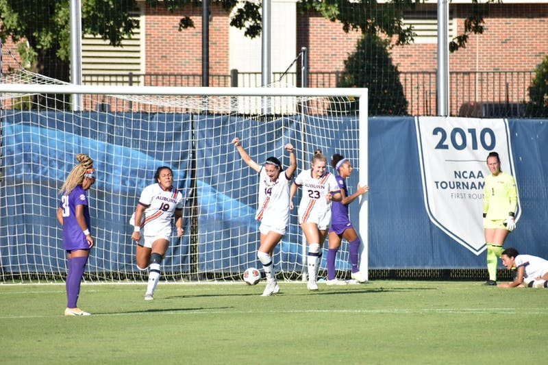 Oct. 10, 2021; Auburn, AL, USA; Auburn celebrates as an LSU player looks on after scoring the game-winning goal in overtime in a match between Auburn and LSU at the Auburn Soccer Complex.