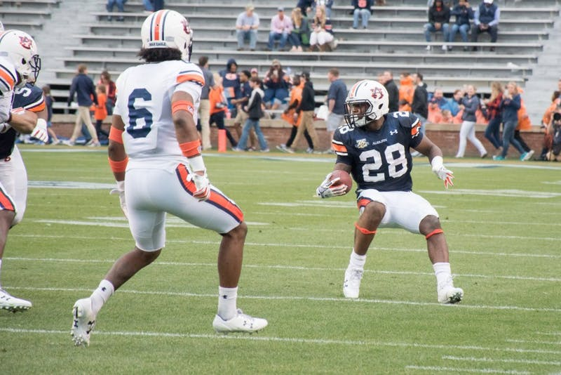 The orange team defeats the blue team at the A-Day game on Saturday, April 7, 2018, in Auburn, Ala.