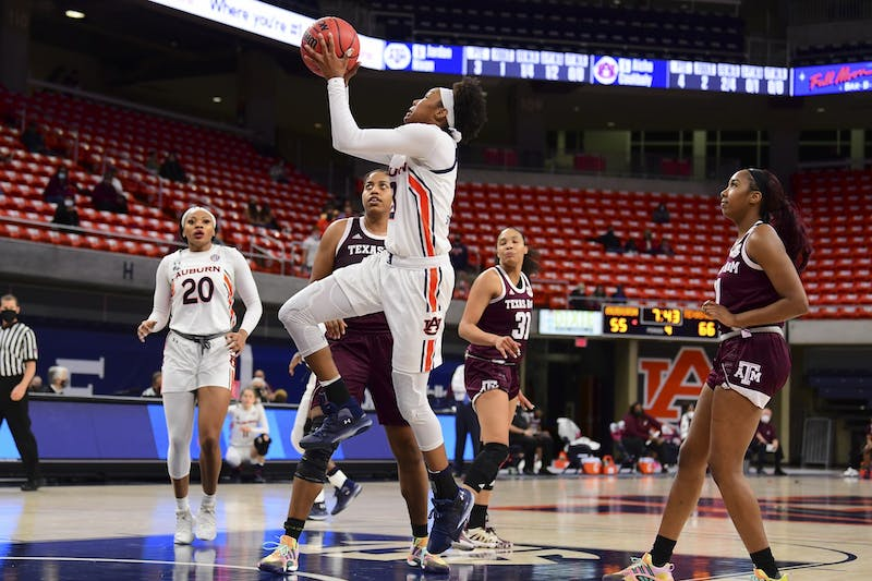 Jan 28, 2021; Auburn, AL, USA; Auburn Tigers guard Honesty Scott-Grayson (23) goes up for a shot during the game between Auburn and Texas A&M at Auburn Arena. Mandatory Credit: Shanna Lockwood/AU Athletics