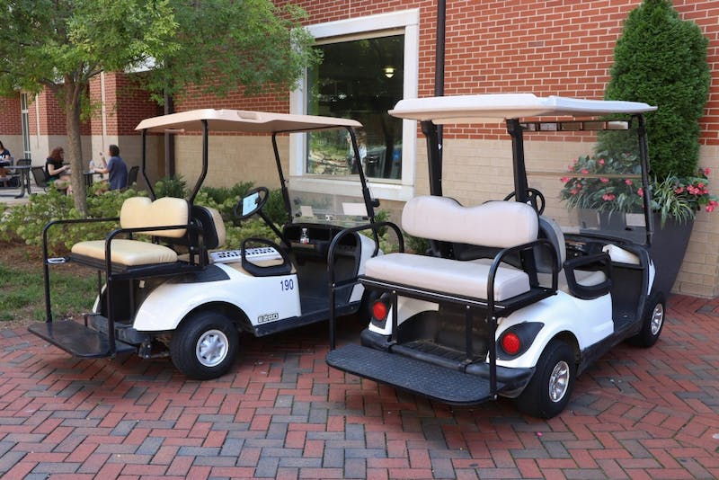 Auburn Universities campus golf carts parked in between the Student Center and Haley Center on Sep. 3, 2019, in Auburn, Ala.
