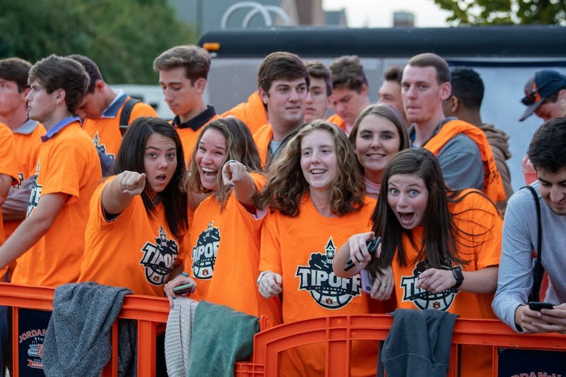 Fans pose for a photo during Tipoff at Toomer's, on Thursday, Oct. 17, 2019, in Auburn, Ala.