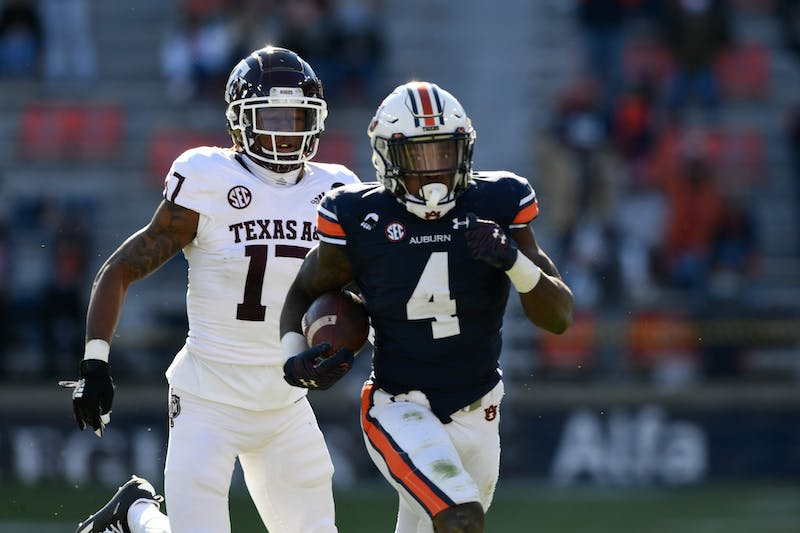 Tank Bigsby (4) getting chased by a defender during the game between Auburn and Texas A&M at Jordan Hare Stadium on Dec. 5, 2020; Auburn AL, USA. Photo via: Todd Van Emst/AU Athletics