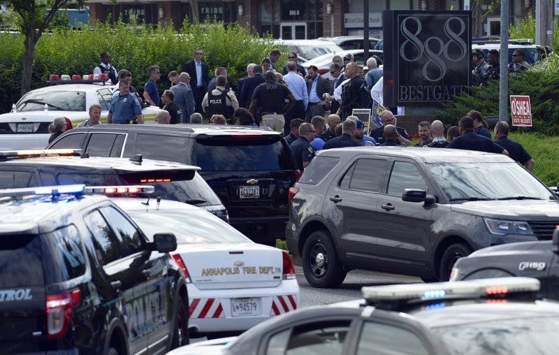 Police secure the scene of a shooting in Annapolis, Md., Thursday, June  28, 2018. A single shooter killed several people Thursday and wounded  others at a newspaper in Annapolis, Maryland, and police said a suspect  was in custody.