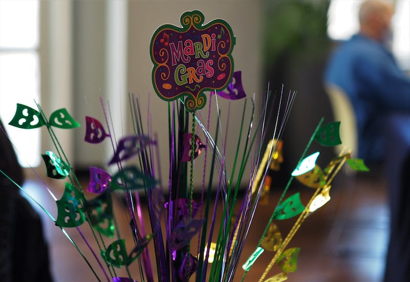 UPC's Mardi Gras pop-up offered participants Moon Pies, Polaroids, and caricature art in the spirit of the holiday to engage students on the semester's first wellness day.