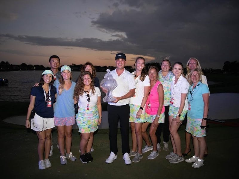 Madison Temple poses for photo with the winner of the Honda Classic.