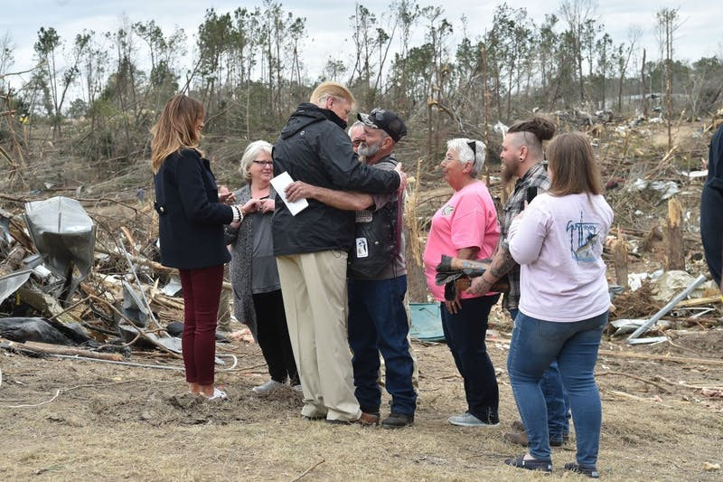 U.S. President Donald Trump greets residents during a tour of tornado-affected areas on March 8, 2019 in Beauregard, Ala. (Nicholas Kamm/AFP/Getty Images/TNS)