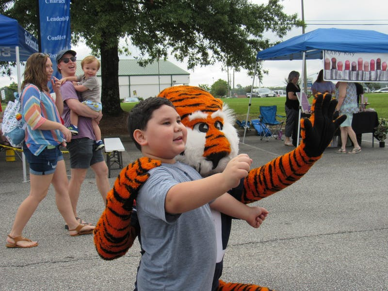 Aubie interacts with a child at the 11th Back 2 School Bash on Aug. 21, 2021, in Auburn, Ala.