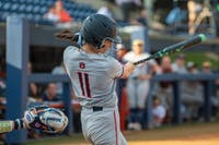 Casey McCrackin (11) swings at the ball during Auburn Softball vs. Villanova on Friday, Feb. 22, 2019, in Auburn, Ala.