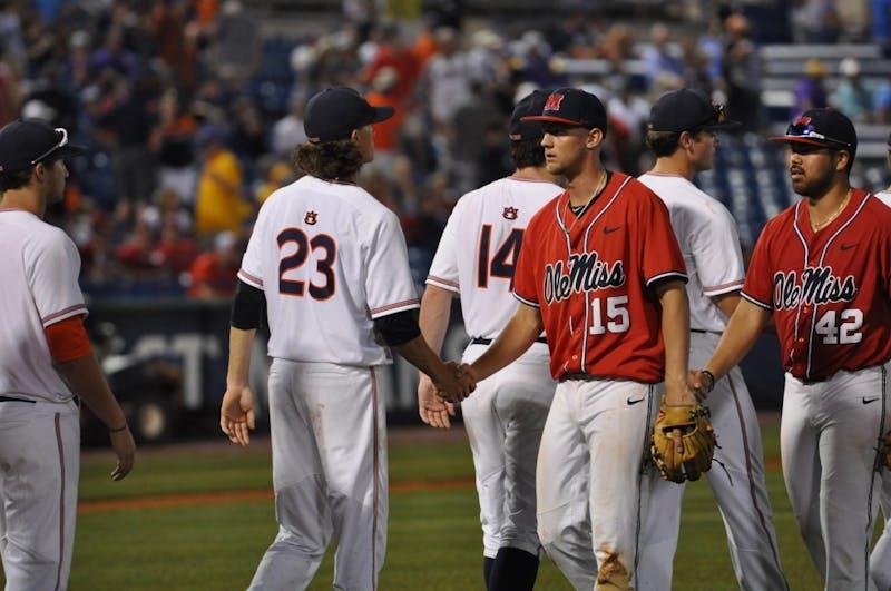 Calvin Coker shakes handsafter Auburn Baseball vs. Ole Miss on Friday,May. 25, 2018 in Hoover, Ala.