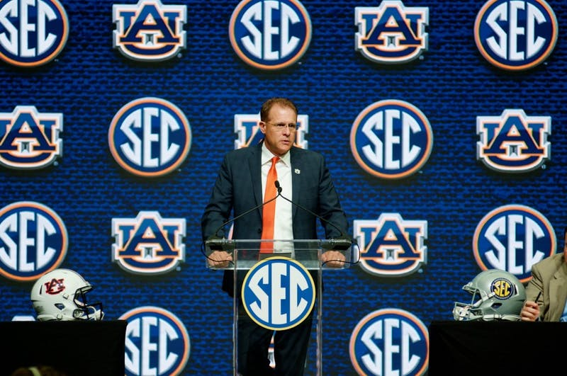 Guz Malzahn answers a question during an interview at SEC Media Days in the College Football Hall of Fame on Thursday, July 19, 2018 in Atlanta, Ga.