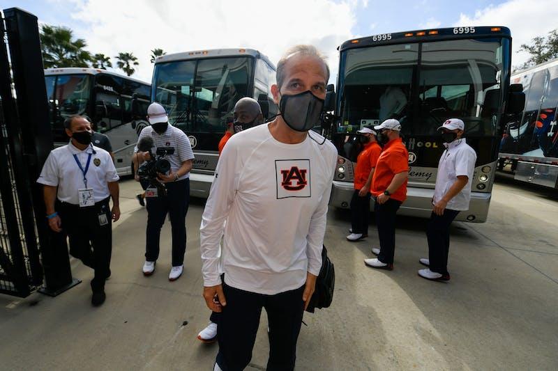 Coach Kevin Steele walking into the stadium before the game between Auburn vs. Northwestern at Orlando on Jan 1, 2021; Orlando FL, USA. Photo via: Todd Van Emst/AU Athletics