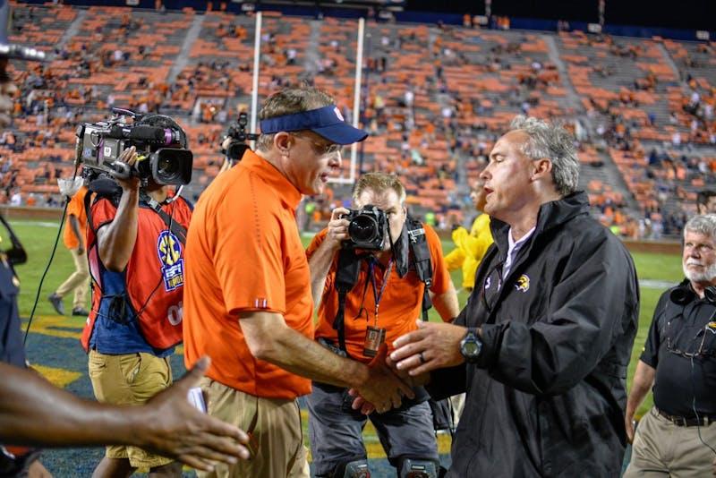 Auburn Coach Gus Malzahn shakes Southern Miss Coach Jay Hopson's hand following Auburn Footballs win over Southern Miss on Saturday, Sept. 29, 2018, in Auburn, Ala.