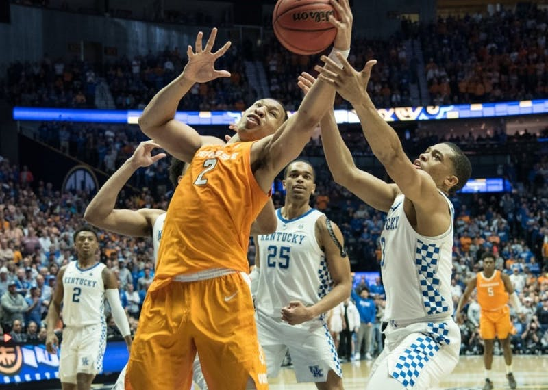 Courtesy of Caitlyn Jordan / The Daily Beacon #2, Grant Williams attempts to retrieve the ball during the the SEC Tournament game against the University of Kentucky at the Bridgestone Arena on Saturday March 16, 2019.