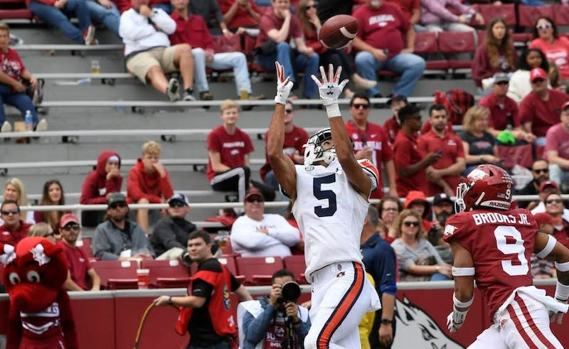 Anthony Schwartz (5) scores a touchdown during Auburn at Arkansas on Oct. 19, 2019, in Fayetteville, Ark.