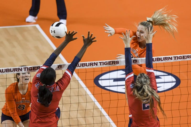 Tatum Shipes (21) hits the ball during Auburn volleyball vs. Ole Miss on Friday, Oct. 26, 2018, in Auburn, Ala.