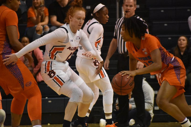 Auburn player Lauren Hansen (13) guards Florida player Kiara Smith (1) at the Auburn v. Florida Women's Basketball Game in Auburn, AL on Janurary 1st, 2020