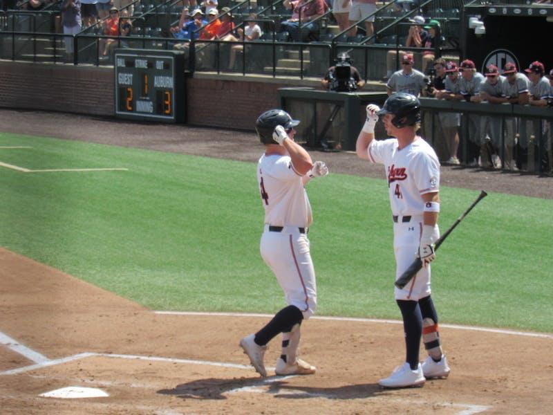 Rankin Woley (4) reaches home plate after hitting a home run against Texas A&M on May 15, 2021; Auburn, AL