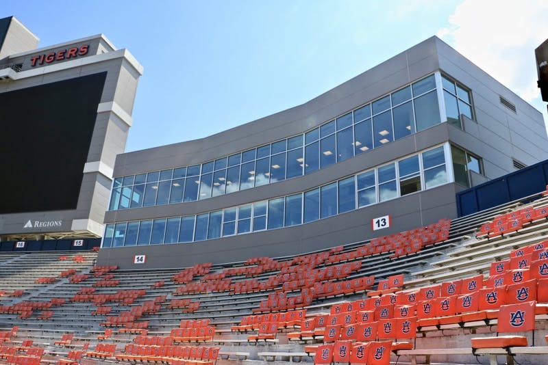 The open window in the bottom right corner of the press box homes the memory and reserved seat of the Voice of the Auburn Tigers in Jordan Hare Stadium on Sept. 2019, in Auburn, Ala.