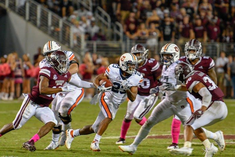 Ryan Davis (23) runs the ball during Auburn Football vs. Mississippi State on Saturday, Oct. 6, 2018, in Starkville, Miss.
