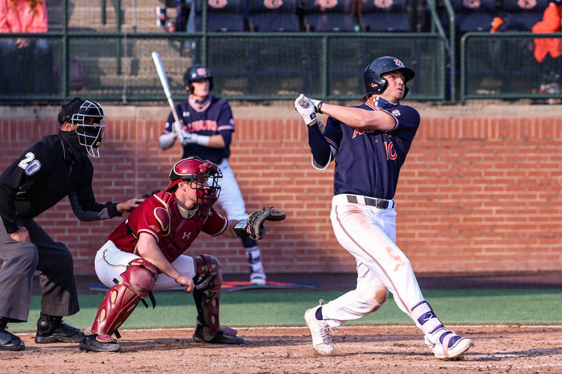 Mar 6, 2021; Auburn, AL, USA; Auburn Tigers infielder/outfielder Tyler Miller (10) watches the ball for a home run during the game between Auburn and Boston College at Auburn Arena. Mandatory Credit: Jacob Taylor/AU Athletics