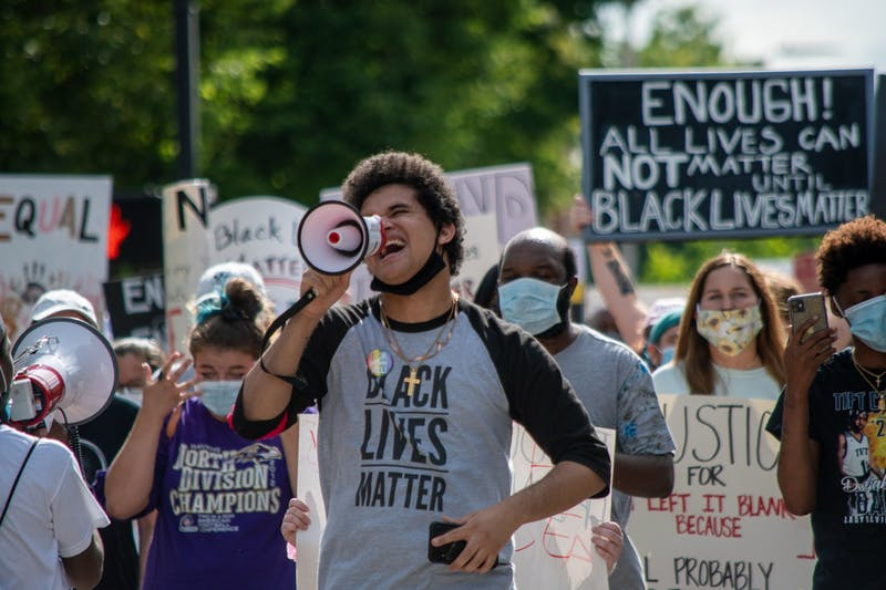 A speaker leads protestors in a chant at the Auburn protest against police brutality, on Sunday, June. 7, 2020, in Auburn, Ala.