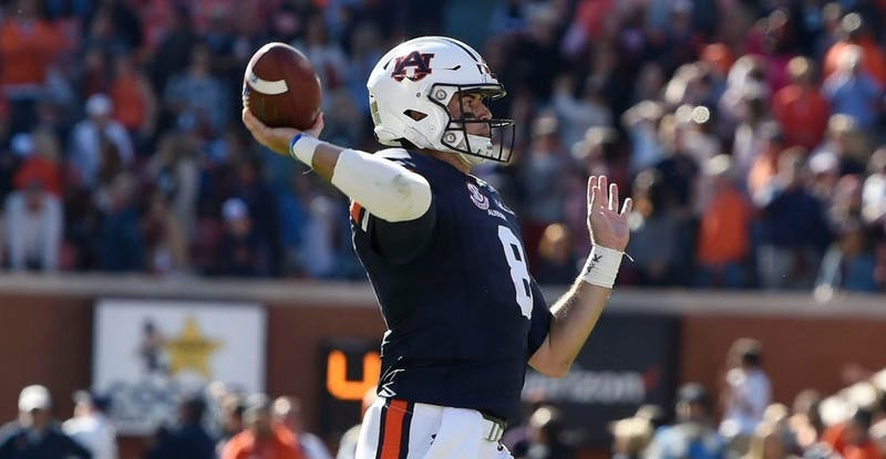 Jarrett Stidham (8) throws a pass during Auburn football vs. Texas A&M on Nov. 3, 2018, in Auburn, Ala.