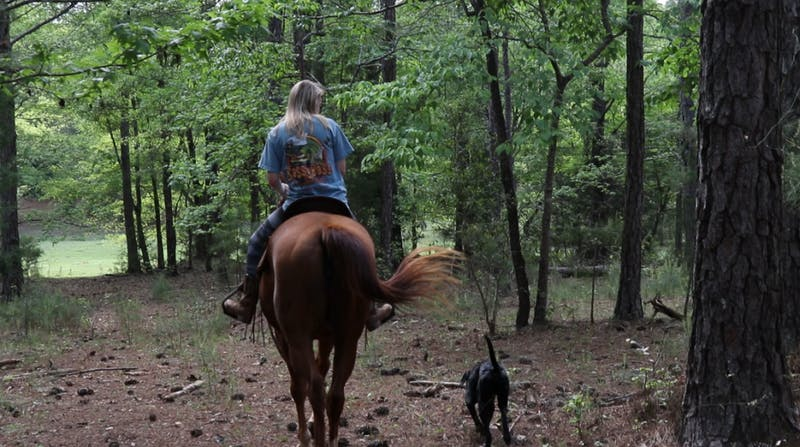 Savannah Valentine rides her horse, Wildcard, in Opelika.