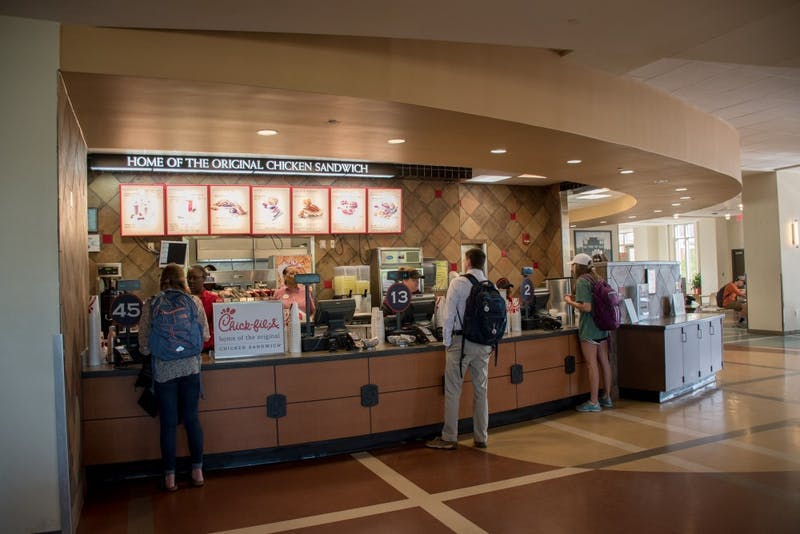 Students wait for their food at the on-campus Chick-fil-A on Wednesday, 11, 2018, in Auburn, Ala.