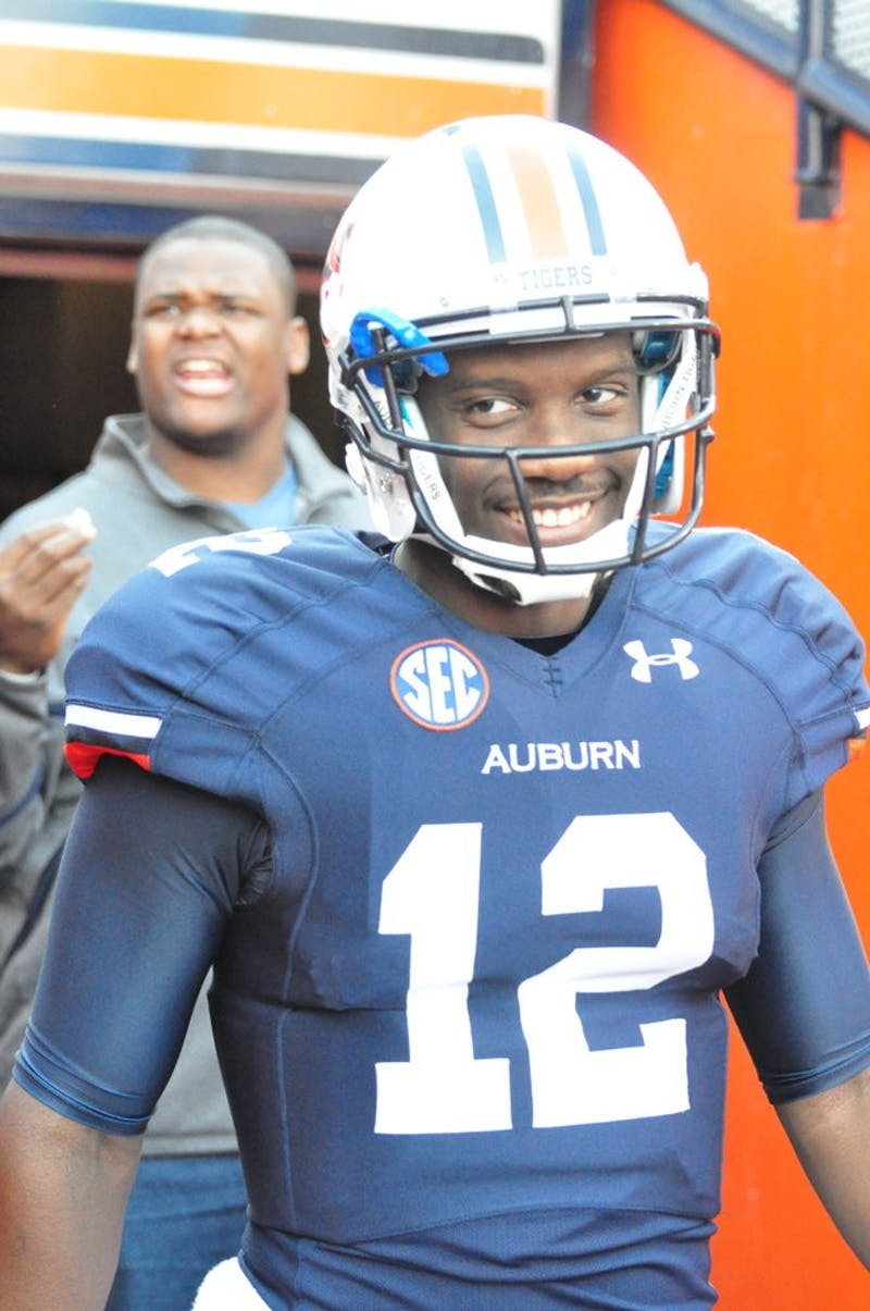 Jonathan Wallace enters the field before the 2013 Iron Bowl.  Wallace recently moved from quarterback to wide receiver. (File photo)