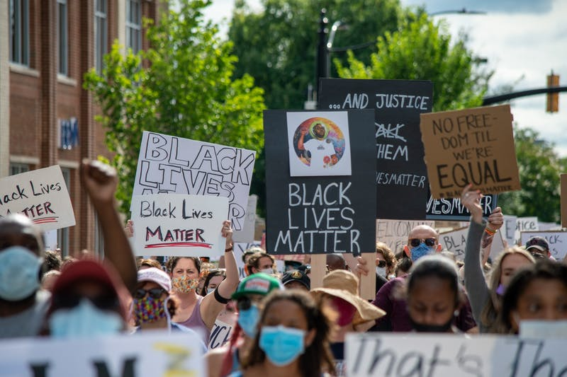 A crowd marches at the Auburn Protest against Police Brutality, on Sunday, June. 7, 2020, in Auburn, Ala.