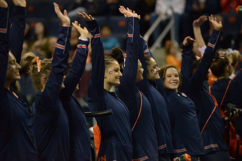 Auburn gymnasts turns to the crowd during Auburn gymnastics vs. Missouri.