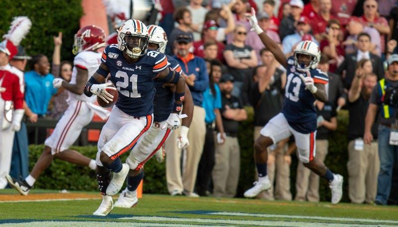 Smoke Monday (21) returns an interception for a touchdown during Auburn football vs. Alabama on Nov. 30, 2019, in Auburn, Ala.