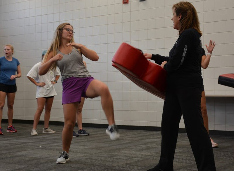 Self-defense participant executes a kick, Oct. 9, 2018.