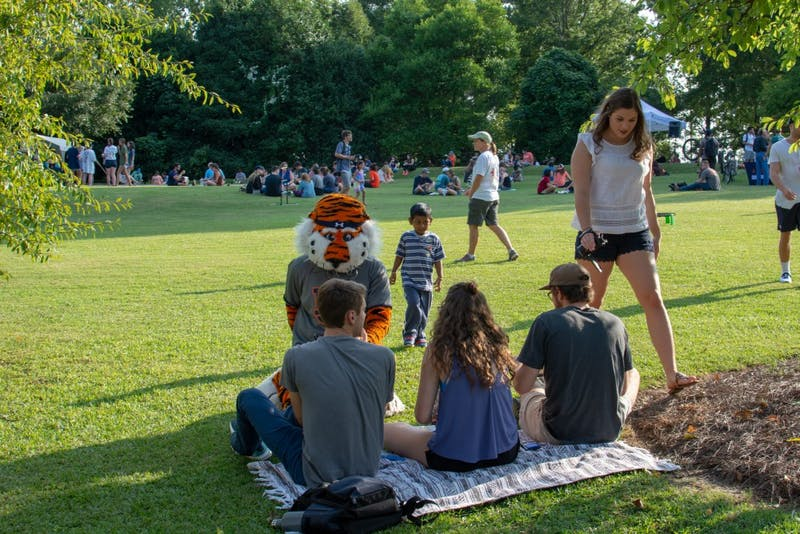 Members of the public spend some time with Aubie during the Sustainability Picnic at Donald E. Davis Arboretum, on Wednesday, Aug. 22, 2018, in Auburn, Ala.