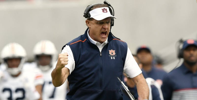 Gus Malzahn celebrates after a score during Auburn at Arkansas on Oct. 19, 2019, in Fayetteville, Ark.