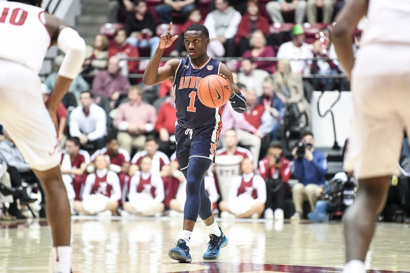Jared Harper (1) dribbles the ball during Auburn men's basketball vs. Alabama on March 3, 2019, in Tuscaloosa, Al.