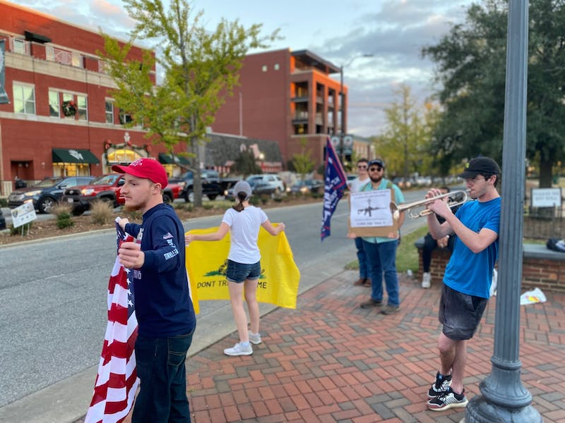 Student gathered at Toomer's Corner for the Freedom Rally to support President Trump through what they allege is voter fraud in the 2020 presidential election.