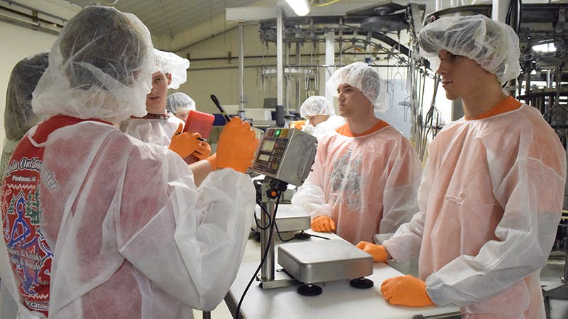 Students work in a poultry science lab.