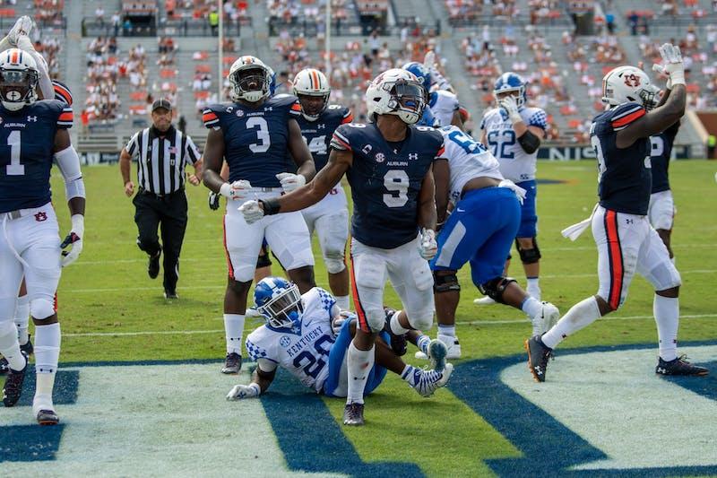 Zakoby McClain (9) celebrates a tackle during Auburn Football vs. Kentucky on Saturday, Sept. 26, 2020, in Auburn, Ala.