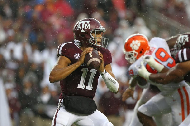Kellen Mond (11) looks to pass during Texas A&M vs. Clemson on Sept. 8, 2018, in College Station, Texas. Photo courtesy of Jesse Everett / The Battalion
