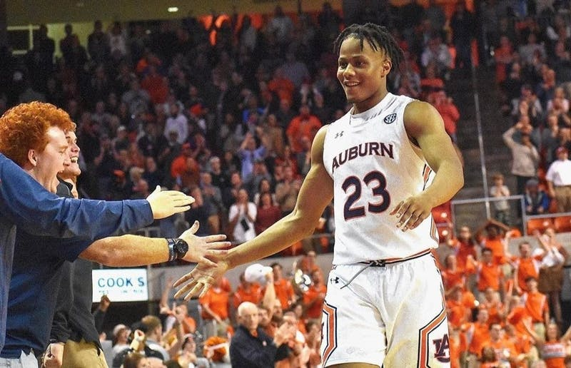 Isaac Okoro (23) high-fives fans courtside during Auburn basketball vs. Vanderbilt on Jan. 8, 2020, in Auburn, Ala.